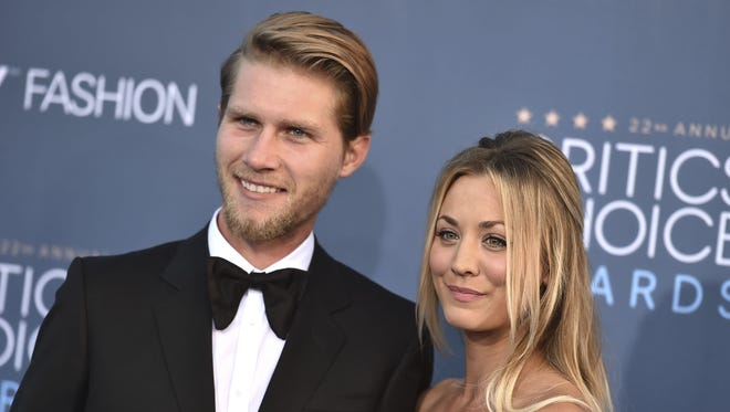 Kaley Cuoco, right, and Karl Cook announced their engagement on Nov. 30, 2017.